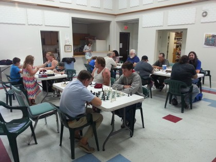 Chess players in the church great room